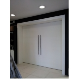 porta pivotante branca para sala Chácara do Piqueri